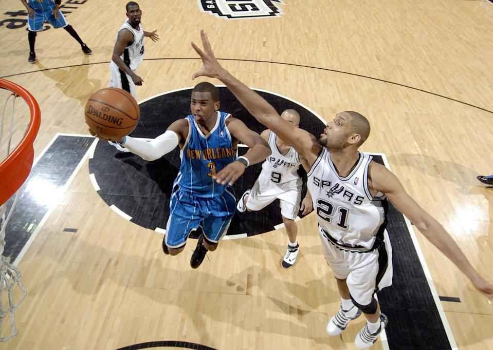 <p>2009: Chris Paul #3 of the New Orleans Hornets drives to the basket for a layup against Tony Parker #9 and Tim Duncan #21 of the San Antonio Spurs during the game at AT&T Center on April 15, 2009 in San Antonio, Texas. </p>