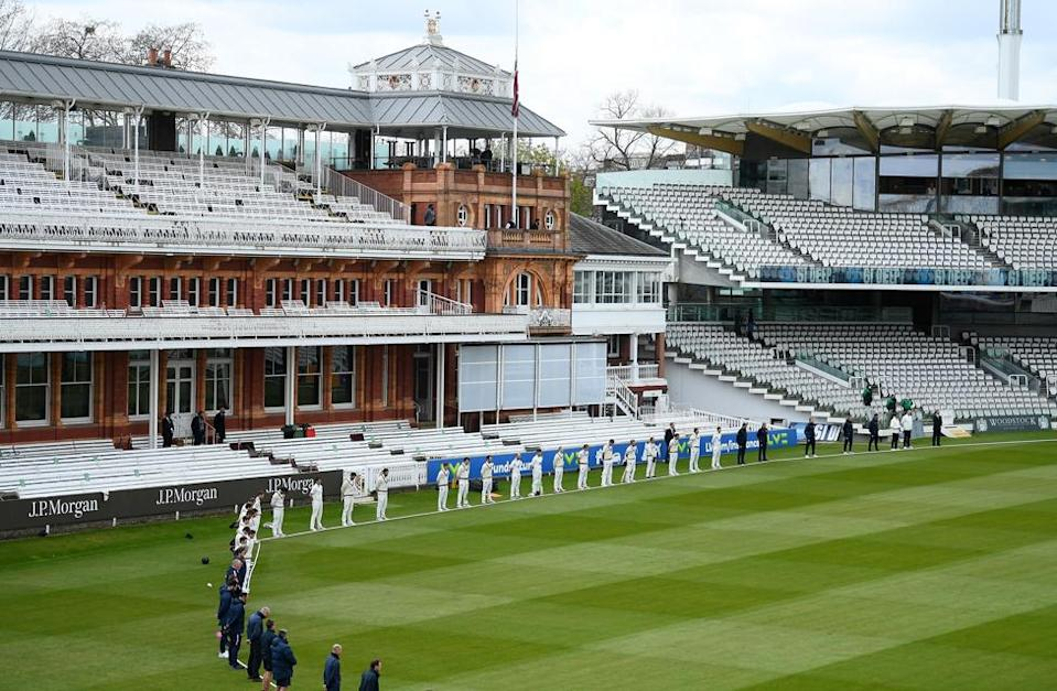 Players and staff at Lord's Cricket Ground hold a two-minute silence