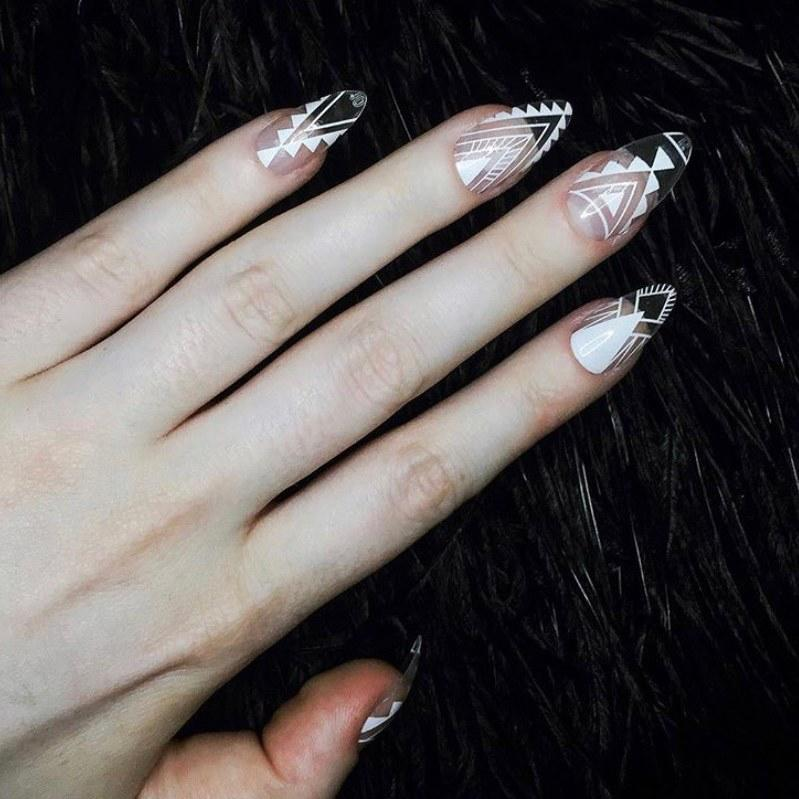 """I like to think of this trend as <a href=""""https://www.allure.com/gallery/negative-space-nail-art-how-to?mbid=synd_yahoo_rss"""">negative space nail art's</a> long lost sister. The only real difference between the two styles is that that to accomplish see-through nails you need to have acrylics, whereas, with a negative space look, you do not. Once the acrylics are placed on, you can go nuts with any design style — just be sure it doesn't cover the entire nail. That way, you don't lose the see-through effect. Pictured here is <a href=""""https://www.instagram.com/magdarling"""">Magdalena's geometric design</a>."""