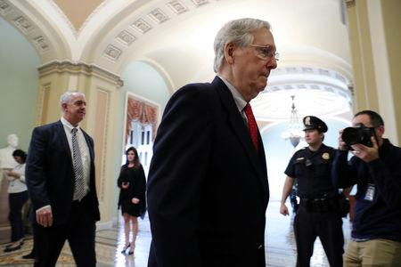 FILE PHOTO: U.S. Senate Majority Leader Mitch McConnell (R-KY) walks to the Senate floor to speak and vote after meeting with U.S. President Donald Trump at the White House, as deadlines for a federal government shutdown loom in Washington, U.S. December 21, 2018. REUTERS/Jonathan Ernst/File Photo