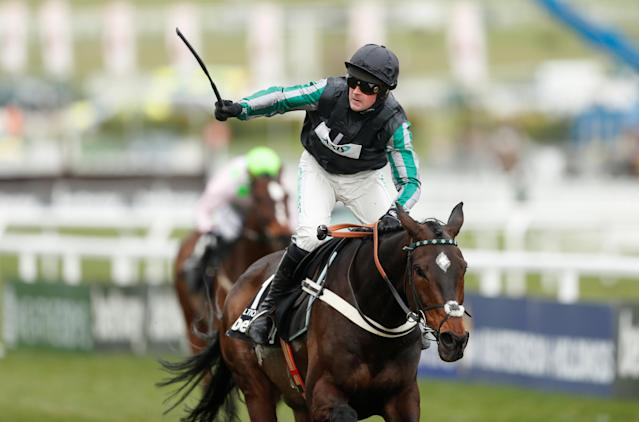 Horse Racing - Cheltenham Festival - Cheltenham Racecourse, Cheltenham, Britain - March 14, 2018 Nico de Boinville celebrates after riding Altior to victory in the 15:30 Betway Queen Mother Champion Chase Action Images via Reuters/Matthew Childs