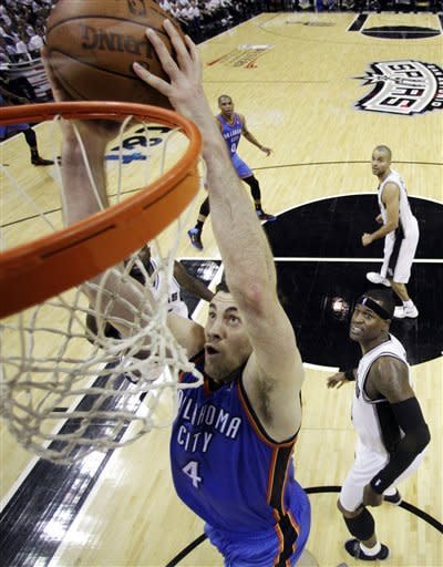 Oklahoma City Thunder power forward Nick Collison (4) dunks as San Antonio Spurs shooting guard Stephen Jackson (3) watches during the first half of Game 5 in the NBA basketball Western Conference finals, Monday, June 4, 2012, in San Antonio. (AP Photo/Eric Gay, Pool)
