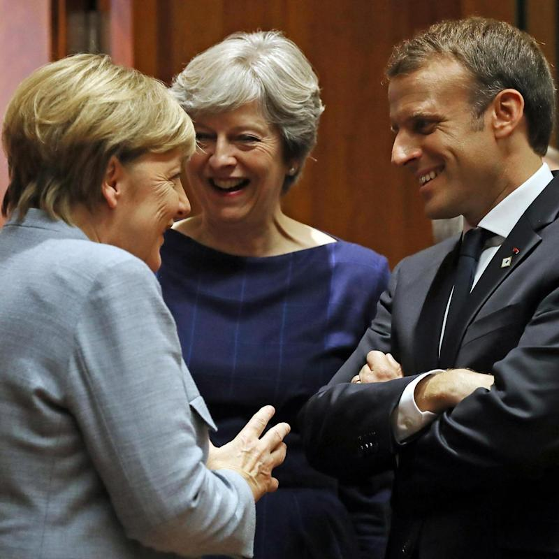Negotiations: The three world leaders chatted together at the start of the summit (Getty Images)