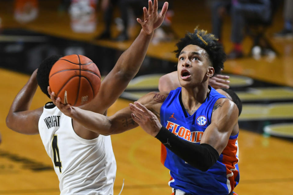 FILE - In this Dec. 30, 2020, file photo, Florida guard Tre Mann shoots as Vanderbilt guard Jordan Wright defends during an NCAA college basketball game in Nashville, Tenn. Mann was selected by the Oklahoma City Thunder in the NBA draft Thursday, July 29. (AP Photo/John Amis, File)