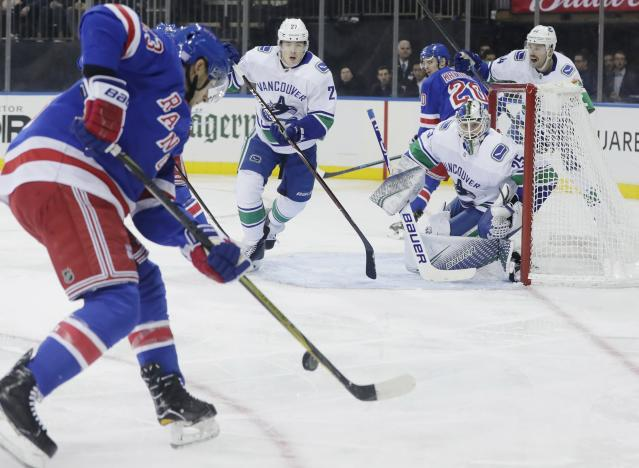Vancouver Canucks goaltender Jacob Markstrom (25) watches New York Rangers' Ryan Spooner (23) during the second period of an NHL hockey game Monday, Nov. 12, 2018, in New York. (AP Photo/Frank Franklin II)