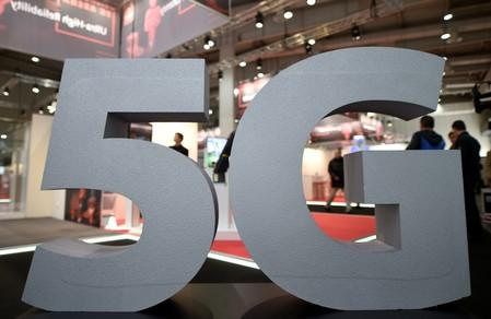 A logo of the upcoming mobile standard 5G is pictured at the Hanover trade fair, in Hanover