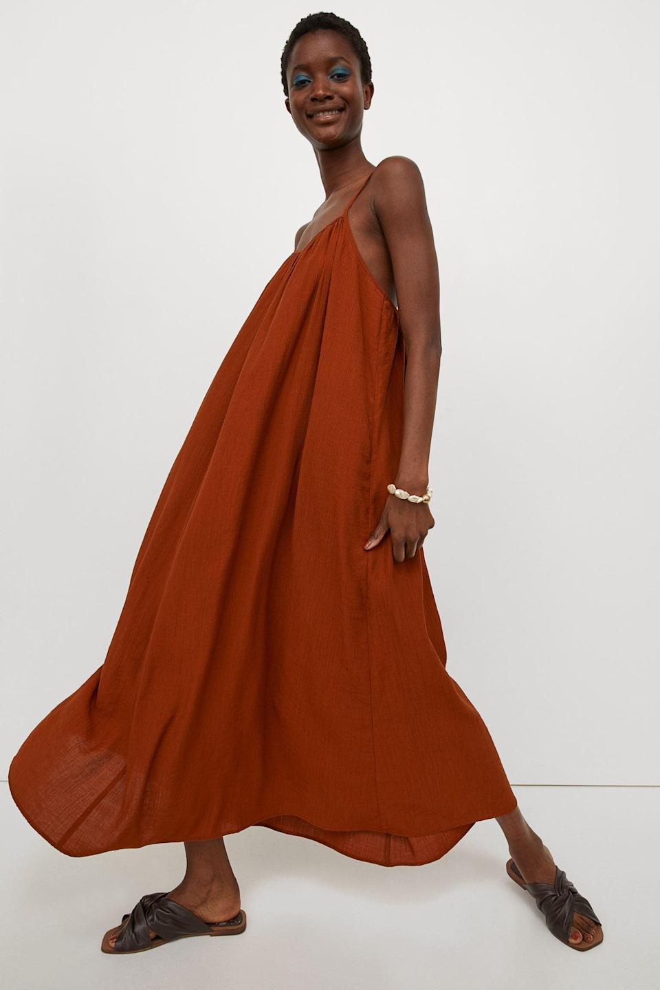 <p>This <span>Wide-cut Long Dress</span> ($50) can literally do it all. By adding some heeled mules and a small shoulder bag, you'll dress it up for an alfresco dinner. But you can also dress it down with some sneakers and a baseball cap for off-duty weekends.</p>
