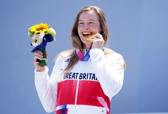 Charlotte Worthington celebrates her gold medal in the women's BMX freestyle