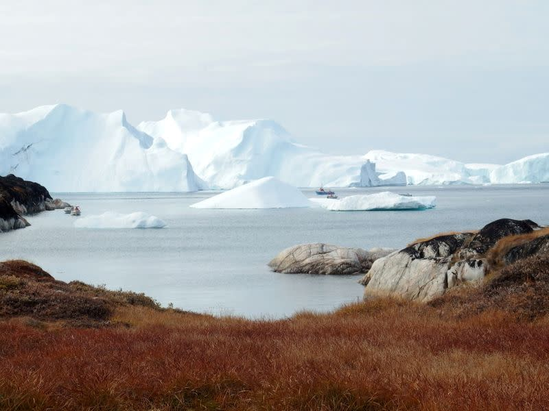 FILE PHOTO: Fishing vessels are seen next to the icebergs near Ilulissat