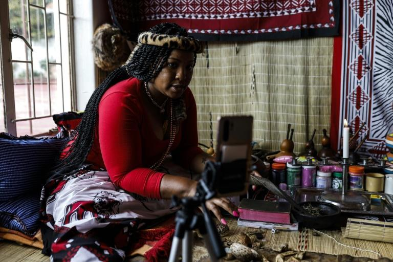 Some traditional healers now find themselves throwing bones in front of an iPhone to maintain a link to their clients