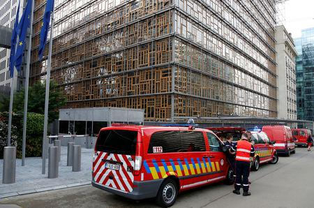 Emergency services vehicles are seen outside the European Union Council building after noxious gases were found in its kitchens in Brussels, Belgium October 13, 2017. REUTERS/Francois Lenoir