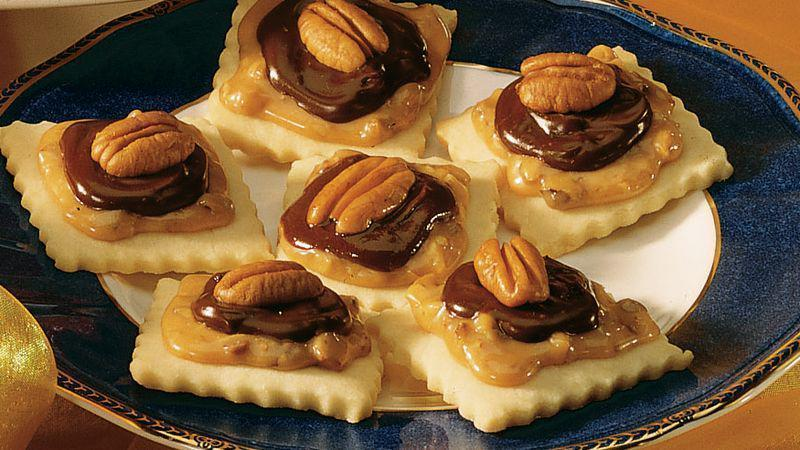 """<p>These treats taste even better than <a href=""""https://www.thedailymeal.com/eat/popular-candy-us-states?referrer=yahoo&category=beauty_food&include_utm=1&utm_medium=referral&utm_source=yahoo&utm_campaign=feed"""" rel=""""nofollow noopener"""" target=""""_blank"""" data-ylk=""""slk:America's favorite candy bars"""" class=""""link rapid-noclick-resp"""">America's favorite candy bars</a>. The vanilla bar cookies are topped with a caramel-pecan filling and a chocolate glaze. </p> <p><a href=""""https://www.thedailymeal.com/recipes/candy-bar-cookies-recipe-0?referrer=yahoo&category=beauty_food&include_utm=1&utm_medium=referral&utm_source=yahoo&utm_campaign=feed"""" rel=""""nofollow noopener"""" target=""""_blank"""" data-ylk=""""slk:For the Candy Bar Cookies recipe, click here."""" class=""""link rapid-noclick-resp"""">For the Candy Bar Cookies recipe, click here.</a></p>"""