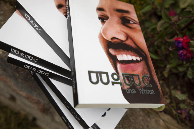 Copies of the new book by Prime Minister Dr Abiy Ahmed on MEDEMER (synergy) after it was launched Saturday Oct. 19, 2019, at the Ethiopian capital Addis Ababa. Ethiopia's Nobel Peace Prize-winning prime minister's book of his ideology, with one million copies already printed. Saturday's launch again raises concerns among some in the East African nation that a cult of personality could spring up around Prime Minister Abiy Ahmed, who announced sweeping political reforms after taking office last year.  (AP Photo/Mulugeta Ayene)