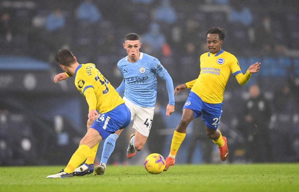 Phil Foden carries the ball forwardsGetty