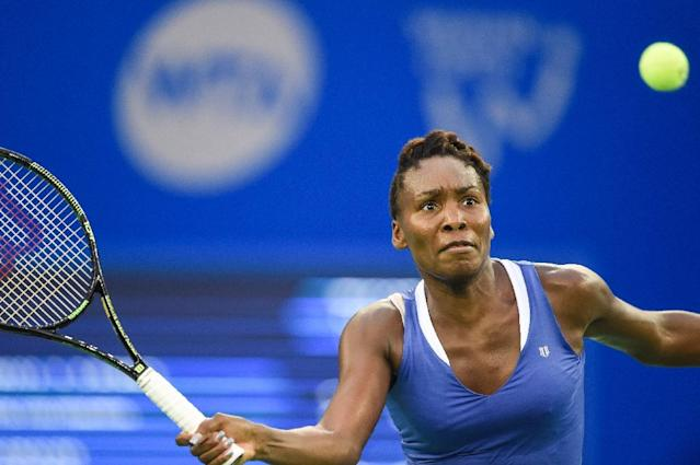 Venus Williams of the US hits a return against Roberta Vinci of Italy in their women's singles semi-final match during the Wuhan Open tennis tournament in Wuhan, in China's Hubei province on October 2, 2015 (AFP Photo/Fred Dufour)