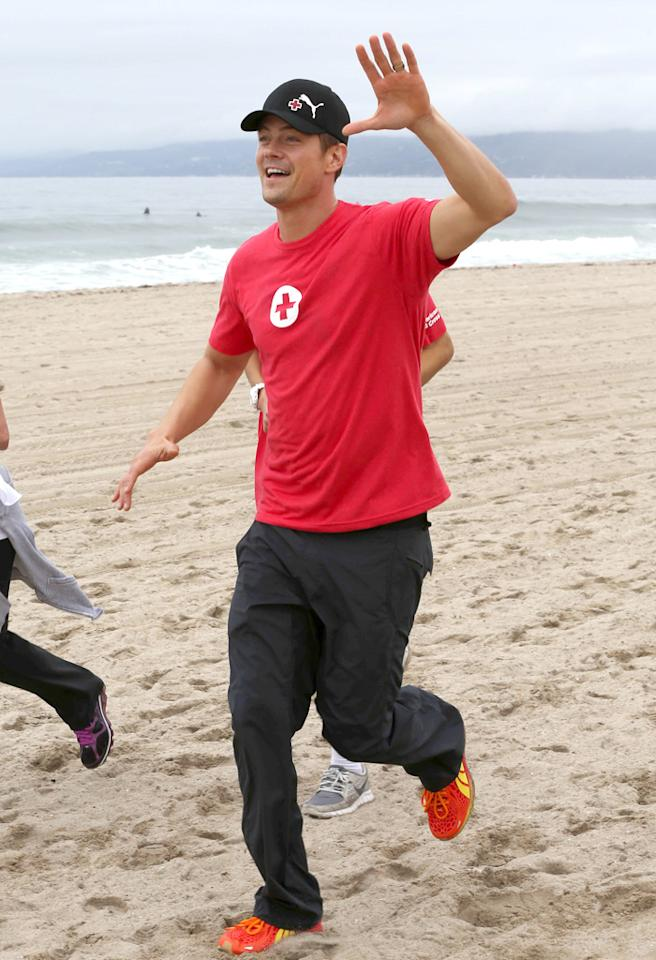 Josh Duhamel running for the Red Cross Youth Run on Santa Monica Beach, CA.