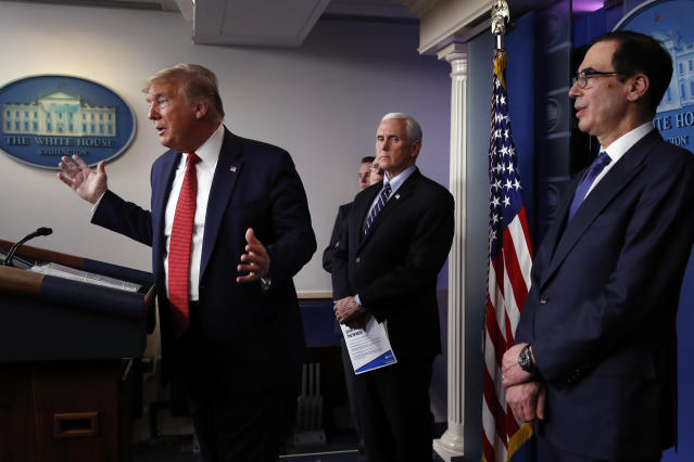 President Trump at the White House on Wednesday, with Vice President Mike Pence and Treasury Secretary Steven Mnuchin. (Alex Brandon/AP)