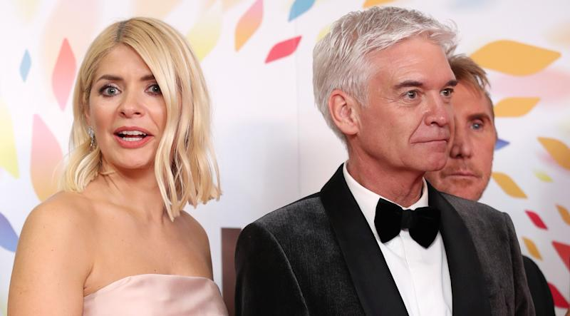 Holly Willoughby and Phillip Schofield tried to keep calm and carry on when a fire alarm went off in the 'This Morning' studio. (Getty Images)