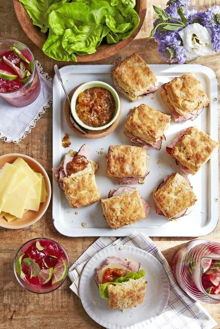 """<p>If you're looking for a more casual spin on the traditional ham recipe and presentation, serve these ham sandwich handhelds instead. They're perfect for lounging around and snacking, or even outdoor gatherings.</p><p><strong><a href=""""https://www.countryliving.com/food-drinks/a26809761/ham-biscuit-sandwiches-apricot-mustard-recipe/"""" rel=""""nofollow noopener"""" target=""""_blank"""" data-ylk=""""slk:Get the recipe"""" class=""""link rapid-noclick-resp"""">Get the recipe</a>.</strong></p><p><strong><a class=""""link rapid-noclick-resp"""" href=""""https://www.amazon.com/dp/B00282JL7G?tag=syn-yahoo-20&ascsubtag=%5Bartid%7C10050.g.4768%5Bsrc%7Cyahoo-us"""" rel=""""nofollow noopener"""" target=""""_blank"""" data-ylk=""""slk:SHOP BAKING SHEETS"""">SHOP BAKING SHEETS</a><br></strong></p>"""
