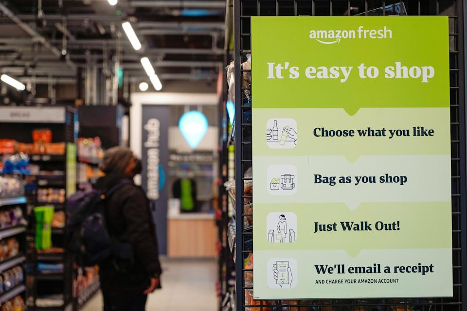 Customers shop for groceries inside Amazon Fresh store in Ealing, west London, the company's first no-checkout store in the UK which opened on Thursday. Photo: Niklas Halle'n/AFP via Getty