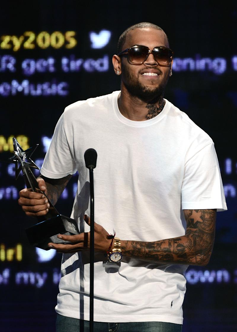 LOS ANGELES, CA - JULY 01:  Recording artist Chris Brown accepts the award for Best Male R&B Artist onstage during the 2012 BET Awards at The Shrine Auditorium on July 1, 2012 in Los Angeles, California.  (Photo by Michael Buckner/Getty Images For BET)