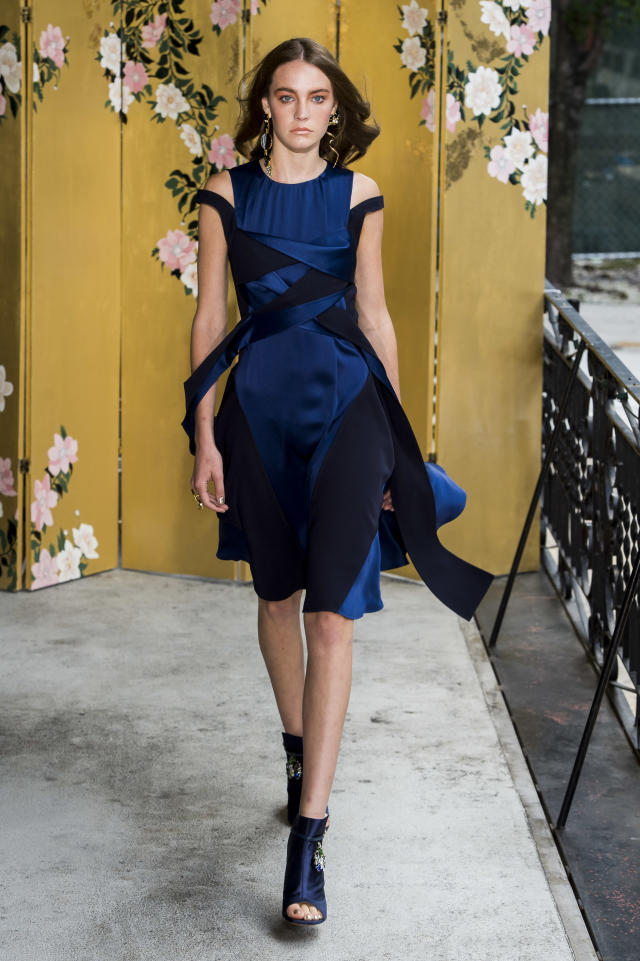 <p><i>Model wears a navy dress from the Adeam SS18 collection. (Photo: ImaxTree) </i></p>