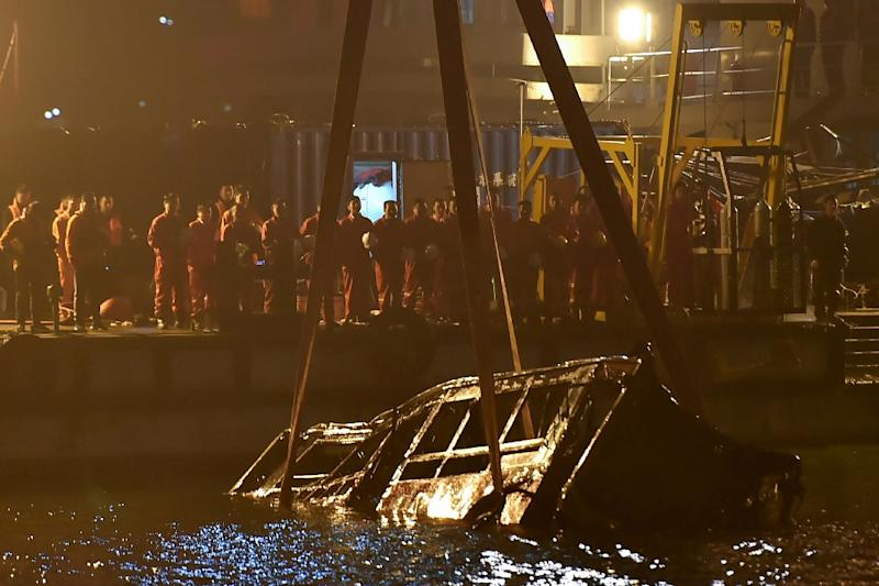 13 killed after fist fight causes China bus to plunge into river