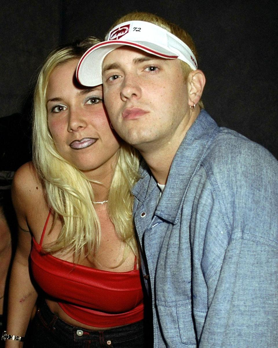 """<p>Eminem and his high school sweetheart, Kimberly Scott, were together during his rise to fame in the late '90s. In 1999, the couple said """"I do."""" However, the rapper and Kim had a <a href=""""https://people.com/music/eminem-daughter-hailie-mother-kim-scott-story/"""" rel=""""nofollow noopener"""" target=""""_blank"""" data-ylk=""""slk:tumultuous relationship"""" class=""""link rapid-noclick-resp"""">tumultuous relationship</a>, and ultimately, they divorced in 2001. While sharing custody of their daughter, they rekindled their relationship and remarried in 2006, but they <a href=""""https://people.com/music/eminem-daughter-hailie-mother-kim-scott-story/"""" rel=""""nofollow noopener"""" target=""""_blank"""" data-ylk=""""slk:didn't sign the marriage license"""" class=""""link rapid-noclick-resp"""">didn't sign the marriage license</a> and were broken up again one month later.</p>"""