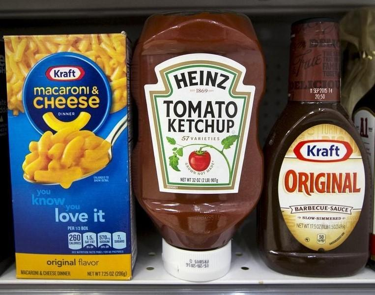 A Heinz Ketchup bottle sits between a box of Kraft macaroni and cheese and a bottle of Kraft Original Barbecue Sauce on a grocery store shelf in New York