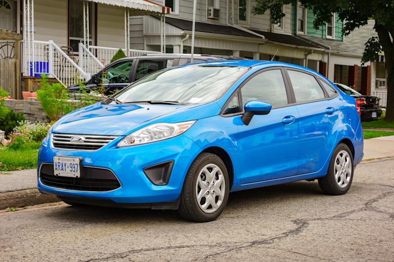 Hamilton, Canada - September 15, 2013: A blue colored Ford Fiesta compact sedan parked on a street in a residential area.