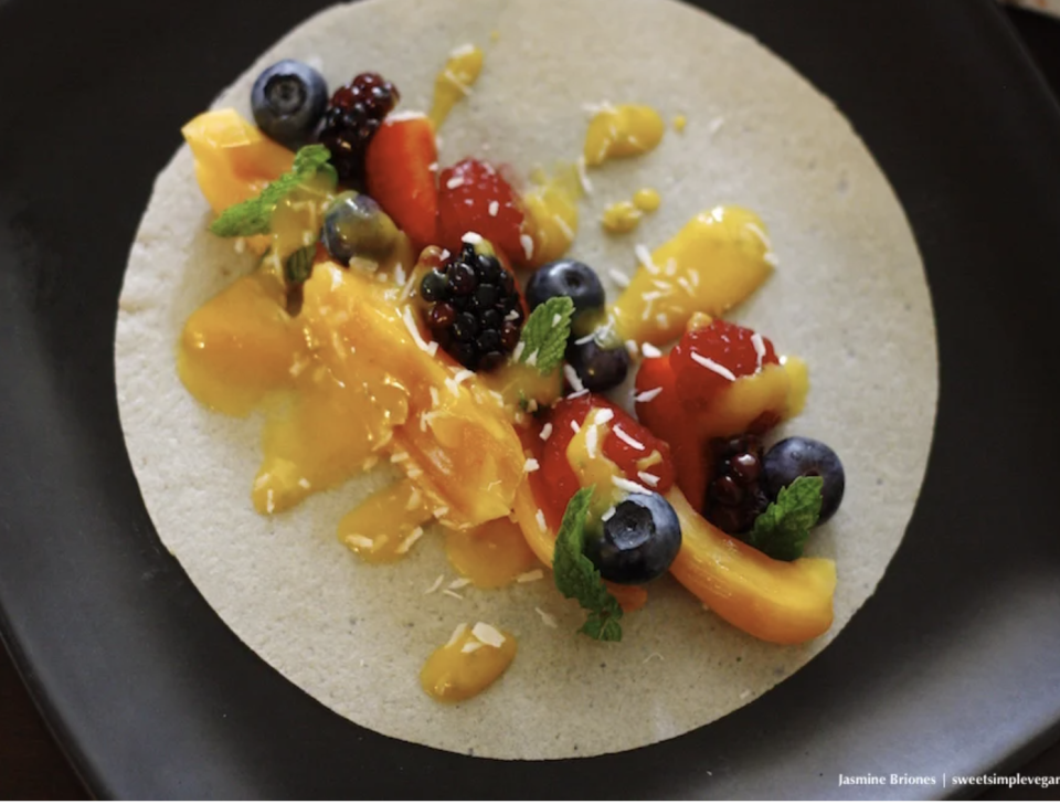 """<p>These tacos are a tasty, fruity spin on a classic Mexican dish, and honestly you can have them as a lunch or dessert. *Whispers both.*<br></p><p><a class=""""link rapid-noclick-resp"""" href=""""https://sweetsimplevegan.com/2015/05/fully-raw-vegan-cinco-de-mayo-coconut-sugar-rimmed-mango-pina-colada-sweet-jackfruit-berry-tacos-w-mango-banana-chia-sauce-mango-lettuce-taco-boats-raw-low-fat/"""" rel=""""nofollow noopener"""" target=""""_blank"""" data-ylk=""""slk:Get the recipe"""">Get the recipe</a></p><p><em>*Nutritional information not available</em></p>"""