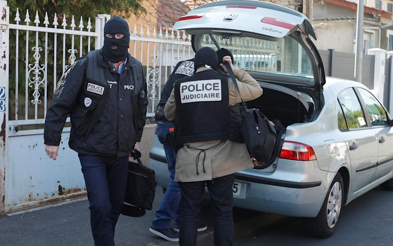 French police leave the house of the gunman killed in a shootout with police on the Champs Elysees Avenue, in the Paris suburb of Chelles - Credit: REUTERS/Charles Platiau