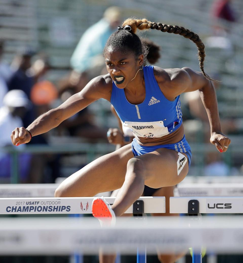 <p>Wearing a long braid, black and white hair bow, and blue lipstick at the 2017 USA Track and Field Championships.</p>