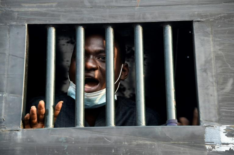 Damilare Adenola, 24, speaks from a truck after being arrested with other protestors at the Lekki tollgate on February 13