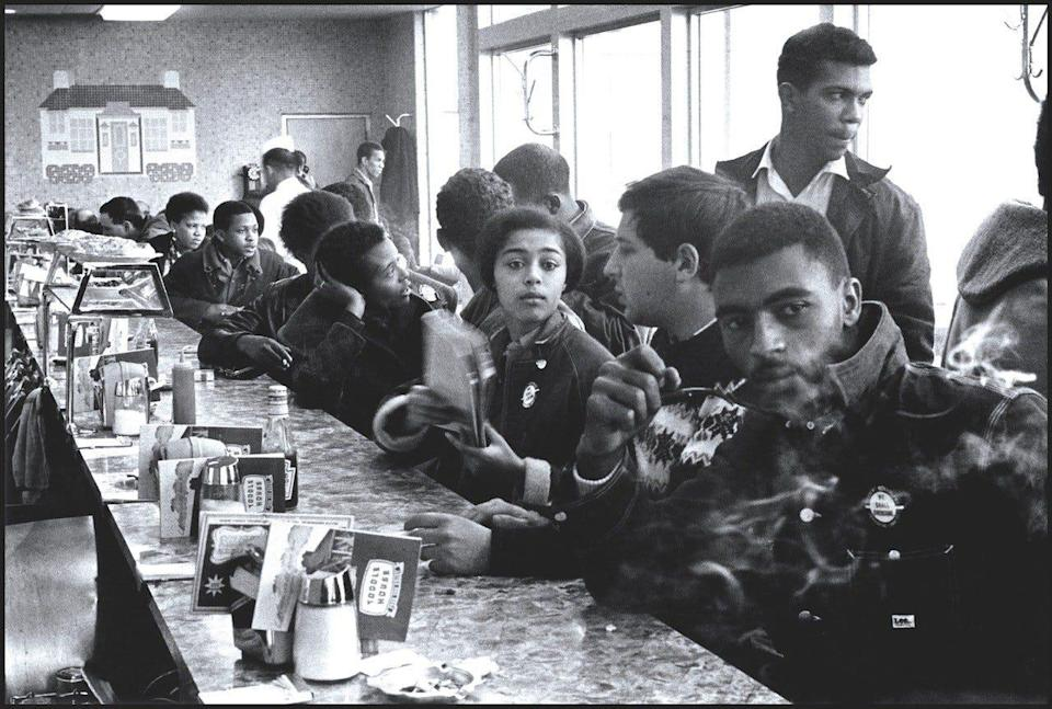 Judy Richardson, a member of the Student Nonviolent Coordinating Committee, joined others at a sit-in at a restaurant in Atlanta in 1963. Others in the photo include Joyce Ladner, Charles Neblett, John Lewis. George Green and Ivanhoe Donaldson