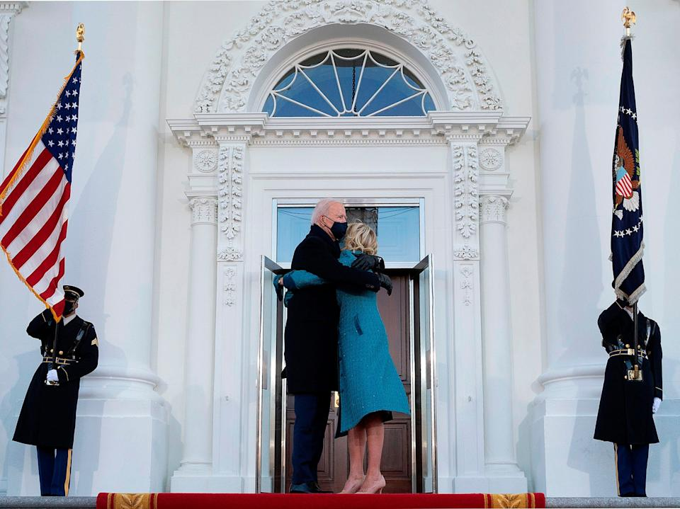 <p>US President Joe Biden hugs First Lady Jill Biden as they arrive at the White House in Washington, DC, on 20 January, 2021</p> (AFP via Getty Images)