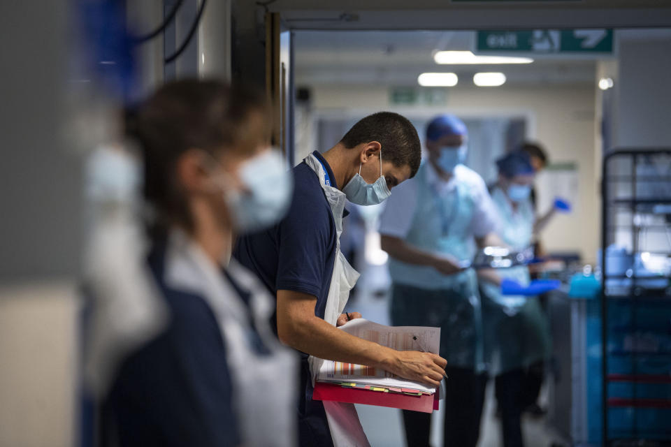 A Rehab Support worker checks on patient notes as the first patients are admitted to the NHS Seacole Centre at Headley Court, Surrey, a disused military hospital, which has been converted during the coronavirus pandemic. Named in honour of Jamaican born nurse, Mary Seacole, the facility will help care for and support patients recovering from COVID-19 and who no longer need care in an acute hospital, or those who have COVID and can no longer cope with their symptoms at home.