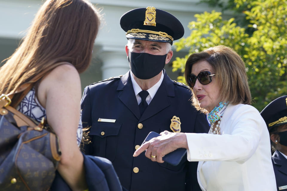 House Speaker Nancy Pelosi of Calif., talks with new U.S. Capitol Police chief Thomas Manger before President Joe Biden signs a bill in the Rose Garden of the White House, in Washington, Thursday, Aug. 5, 2021, that awards Congressional gold medals to law enforcement officers that protected members of Congress at the Capitol during the Jan. 6 riots. (AP Photo/Susan Walsh)
