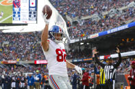 New York Giants tight end Kaden Smith (82) celebrates a touchdown against the Chicago Bears during the first half of an NFL football game in Chicago, Sunday, Nov. 24, 2019. (AP Photo/Paul Sancya)
