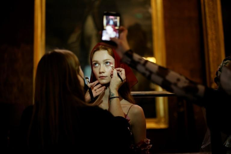 The coronavirus pandemic forced London Fashion Week online last year but it is back on the catwalk after restrictions were lifted (AFP/Tolga Akmen)