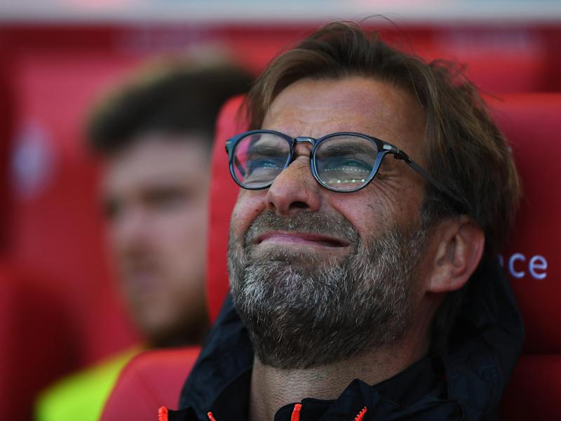 Klopp watches the first-half with a pained expression on his face: Getty