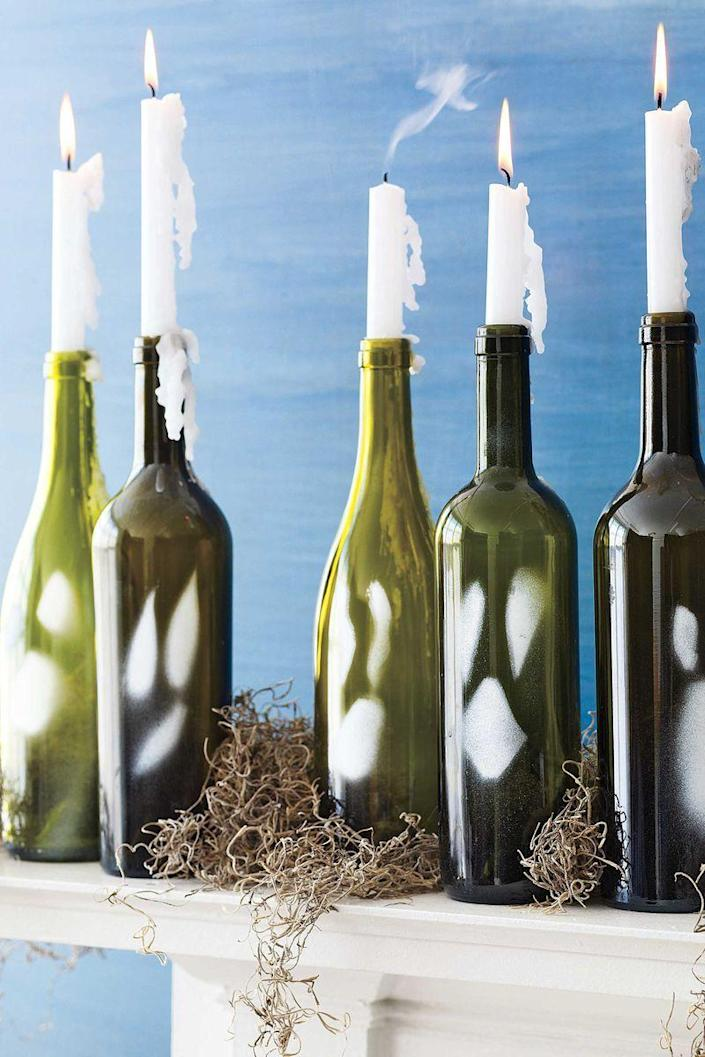 """<p>Create these ghosts from <a href=""""http://www.ebay.com/itm/6-Empty-Green-Wine-Bottles-Cork-Type-750-ML-/222531254708"""" rel=""""nofollow noopener"""" target=""""_blank"""" data-ylk=""""slk:recycled wine bottles"""" class=""""link rapid-noclick-resp"""">recycled wine bottles</a>. Use a paint scraper to remove the label from an empty dark-colored glass wine bottle, and remove any glue with Goo Gone. Finally, draw a scary face using a white paint pen to complete this craft.</p>"""