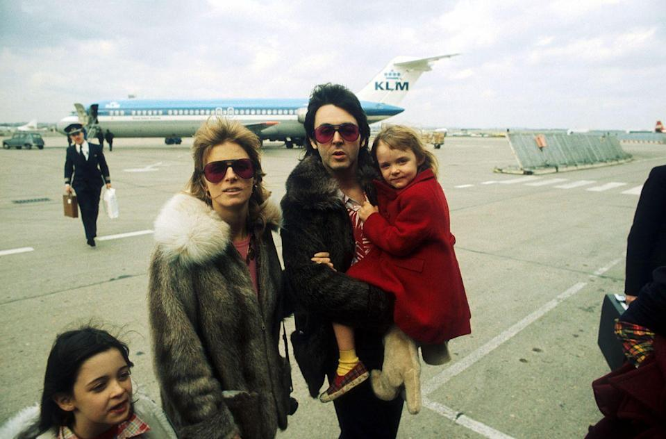 <p>Paul, Linda, and Stella McCartney at the airport in the U.K. in the mid-'70s. </p>