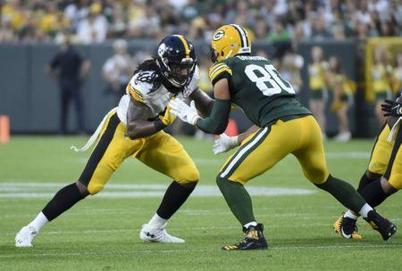 Aug 16, 2018; Green Bay, WI, USA; Pittsburgh Steelers linebacker Bud Dupree (48) tries to get past a block by Green Bay Packers tight end Jimmy Graham (80) in the first quarter at Lambeau Field. Mandatory Credit: Benny Sieu-USA TODAY Sports
