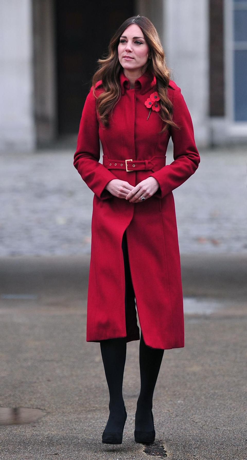 <p>Kate was in all-red for a Poppy Day charity event. She wore a belted coat from L.K. Bennett with black Episode heels. </p><p><i>[Photo: PA]</i></p>