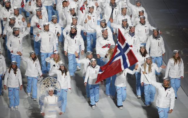Norway's flag-bearer Aksel Lund Svindal leads his country's contingent during the opening ceremony of the 2014 Sochi Winter Olympics, February 7, 2014. REUTERS/Lucy Nicholson (RUSSIA - Tags: OLYMPICS SPORT)