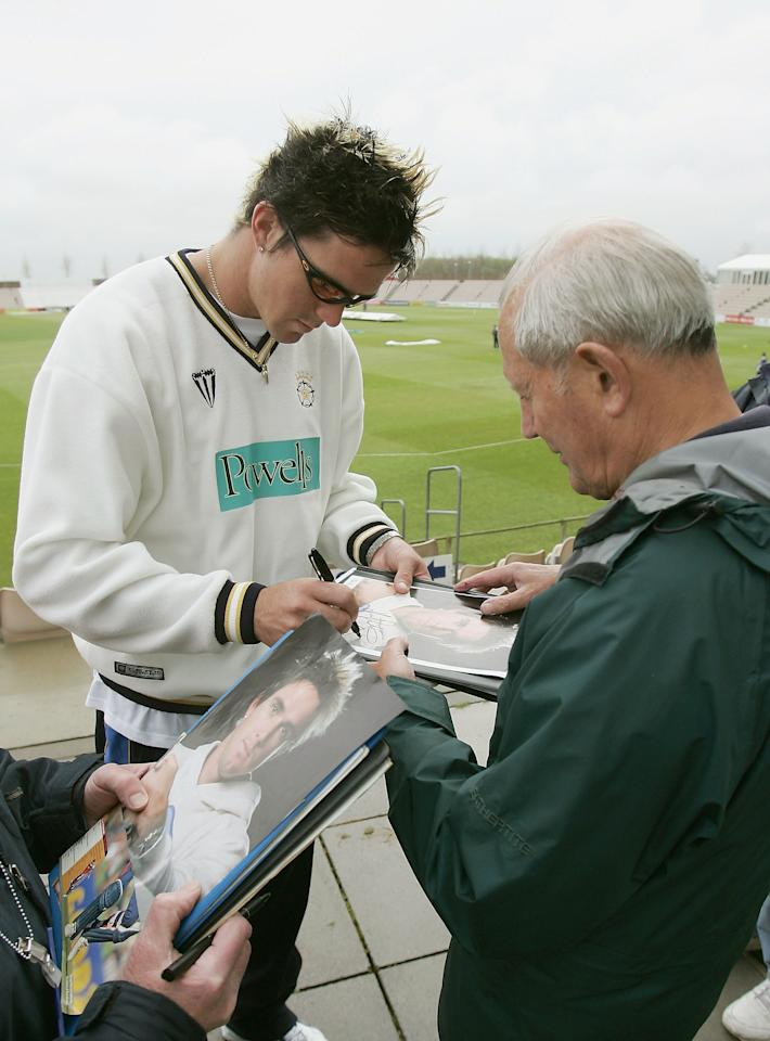 SOUTHAMPTON, ENGLAND - APRIL 13 :  Kevin Pietersen of Hampshire signs autographs after it was announced that he was not playing in the opening game of the Frizzell County Championship Division 1 match  between Hampshire and Glocestershire at Rosebowl on April 13 2005 in Southampton, England.  (Photo by Tom Shaw/Getty Images)