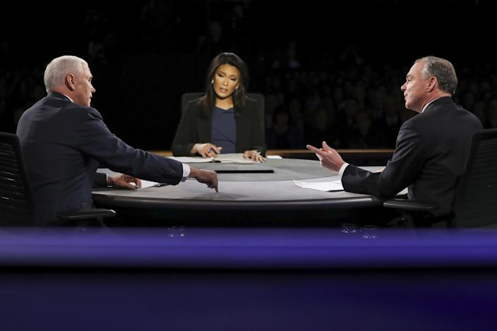Republican vice-presidential nominee Gov. Mike Pence, left, and Democratic vice-presidential nominee Sen. Tim Kaine exchange opinions as Moderator Elaine Quijano of CBS News listens during the vice-presidential debate at Longwood University in Farmville, Va., Tuesday, Oct. 4, 2016. (Photo: Joe Raedle/Pool via AP)