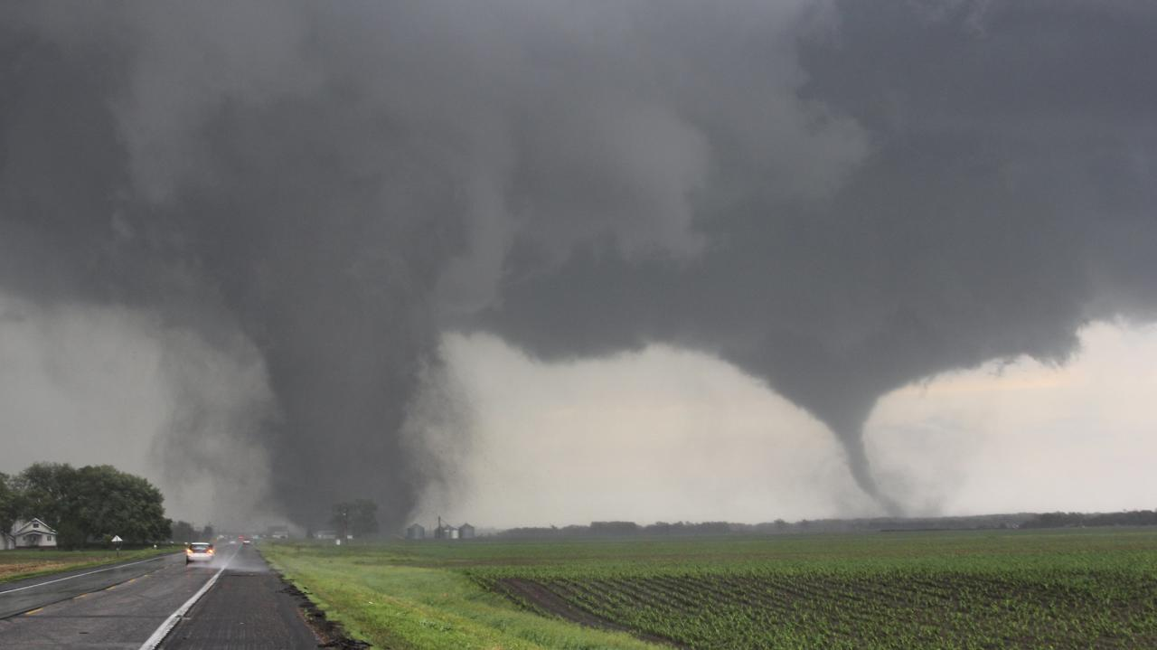 Two tornadoes touch down near Pilger, Nebraska June 16, 2014. Large tornadoes hit rural areas of northeastern Nebraska on Monday afternoon, with reports of property damage, according to forecasters and the Weather Channel. REUTERS/Dustin Wilcox/TwisterChasers (UNITED STATES - Tags: DISASTER ENVIRONMENT TPX IMAGES OF THE DAY) NO SALES. NO ARCHIVES