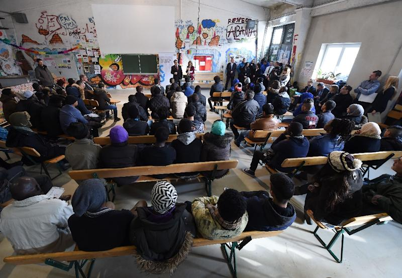 Migrants listen to the rights education lessons for refugees and asylum seekers in Munich, southern Germany on February 24, 2016